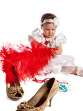 Little girl holding big red feather, isolated royalty free stock photo
