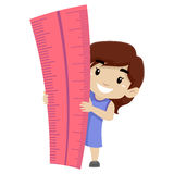 Little Girl holding a Big Ruler Royalty Free Stock Photography