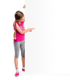 Little girl holding big white blank Royalty Free Stock Image