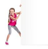 Little girl holding big white blank Stock Photography