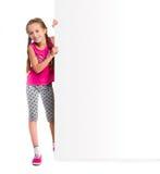 Little girl holding big white blank Stock Photo