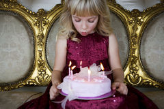 Little girl holding a birthday cake with lit candles Royalty Free Stock Photography