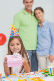 Little girl holding a birthday gift Stock Photo