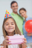 Little girl holding a birthday present Stock Photo