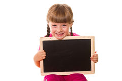 Little girl holding black board on white Royalty Free Stock Photos