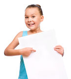 Little girl is holding blank banner Royalty Free Stock Images
