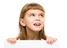 Little girl is holding blank banner Stock Photography