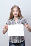 Girl  holding a blank sign Stock Images