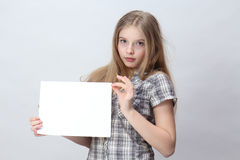 Girl  holding a blank sign Stock Photo