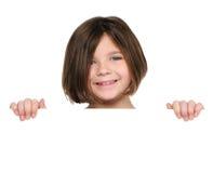 Little girl holding blank sign Stock Images
