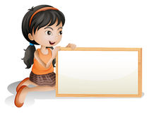 A little girl holding a blank signboard Stock Photo