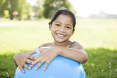 Little girl holding blue ball Royalty Free Stock Photos