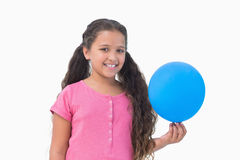 Little girl holding blue balloon Stock Photography