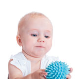 Little girl holding a blue toy Royalty Free Stock Photography