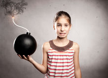 Little girl holding a bomb Royalty Free Stock Images