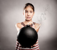 Little girl holding a bomb Royalty Free Stock Photos
