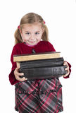 Little girl holding books Royalty Free Stock Photography