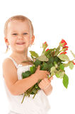 Little girl holding a bouquet of red roses Royalty Free Stock Photography