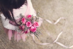 Little girl holding bouquet of rose Royalty Free Stock Photography