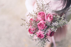 Little girl holding bouquet of rose Royalty Free Stock Image