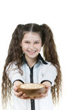 Little girl holding bowl with sesame Royalty Free Stock Photography