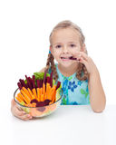 Little girl holding bowl of vegetables Stock Images