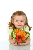Little girl holding a bowl of vegetables Stock Images