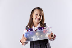 Little girl holding a box with christmas balls Stock Photos
