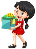 Little girl holding a box of present Royalty Free Stock Photography