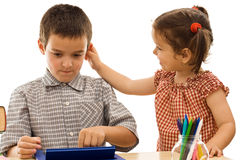 Little girl holding the boy by the ear Stock Photography