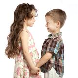 Little girl holding the boy's hand Royalty Free Stock Image