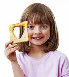 Little girl holding  bread Royalty Free Stock Photography