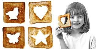Little girl holding  bread Stock Photo