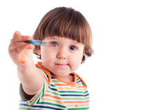 Little girl holding a brush Stock Photo