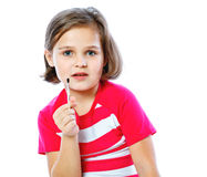 Little girl holding a brush for painting, artist, Royalty Free Stock Photography