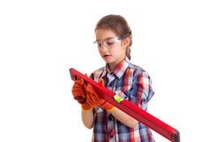 Little girl holding building level Royalty Free Stock Image