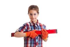 Little girl holding building level Stock Image