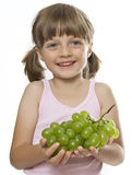 Little girl holding a bunch of grapes Royalty Free Stock Photo