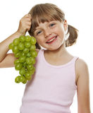 Little girl holding a bunch of green wine grapes Royalty Free Stock Photography
