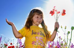 Little girl holding a bunch of  poppy Stock Photos
