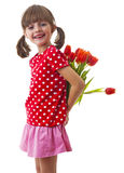Little girl holding bunch of red tulips Royalty Free Stock Photography