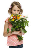 Little girl holding bunch of wildflowers Stock Photos