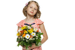 Little girl holding bunch of wildflowers Royalty Free Stock Photo