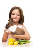 Little girl holding bunny and tulips Stock Image