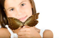 Little girl holding a butterfly Royalty Free Stock Image