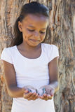Little girl holding a butterfly in the park Royalty Free Stock Photography