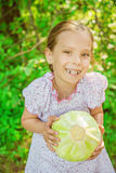 Little girl holding cabbage Stock Photography