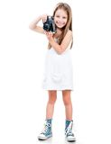 Little girl holding a camera Royalty Free Stock Photography