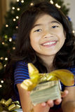 Little girl holding  cash at Christmas Stock Image