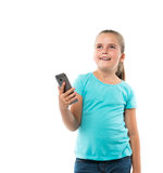 Little girl holding cell phone Royalty Free Stock Images